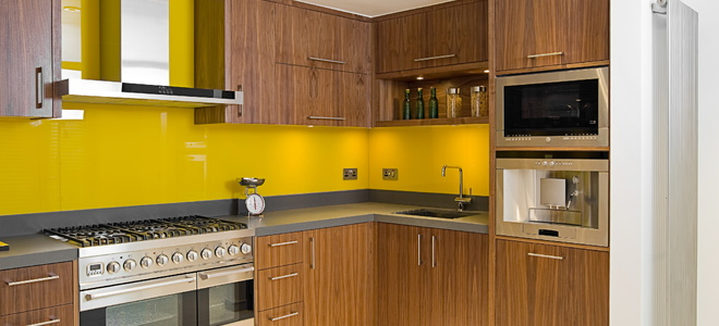 A kitchen with yellow walls.