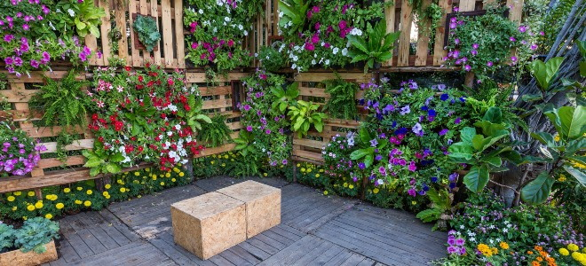 outdoor garden space with vertical planters around a stool