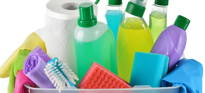 basket of colorful home cleaning products and tools