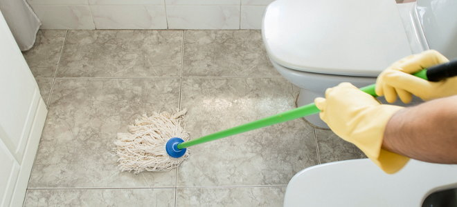 Charmant A Mop Cleaning A Bathroom Floor.