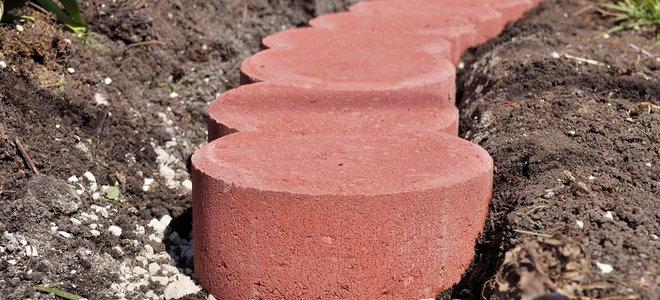 Install brick driveway edging in 6 steps doityourself step 6 edge away the grass solutioingenieria Gallery