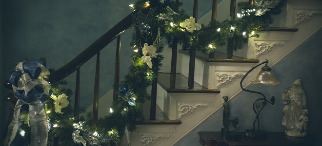 Christmas lights and garland on a stair banister