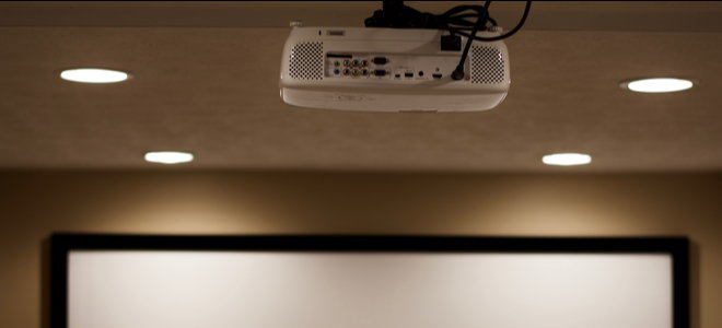 top of projector screen with ceiling mounted projector