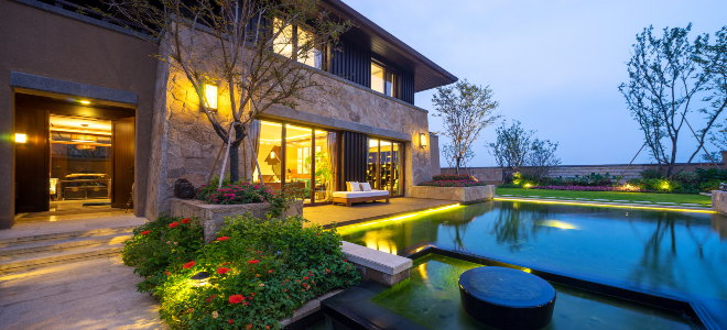 beautiful home with pool and outdoor lighting
