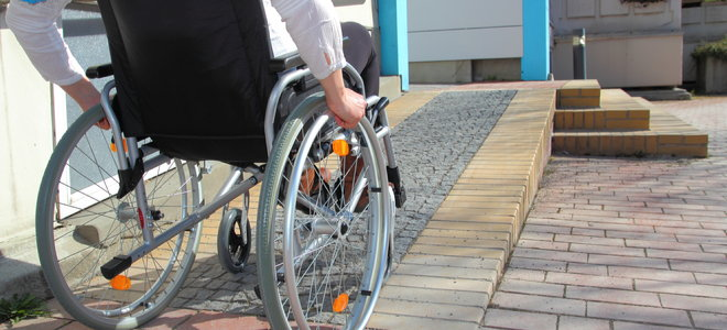 a person in a wheelchair leads up a ramp