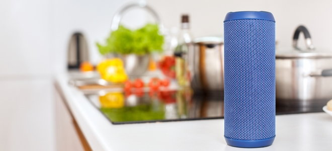 smart speaker in the kitchen next to food and sink
