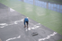 man applying epoxy to a large floor