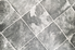 grey and white wall that looks like a tile pattern