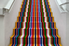 A multi-colored striped set of stairs.