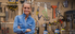 HGTV Star Nicole Curtis standing in a workshop with Bernzomatic blow torches.