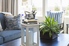 A trendy living room with blue and white tones