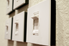 a group of dimmer switches mounted on a cream colored wall