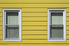yellow aluminum siding on a house