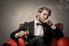 man in a chair smoking a cigar