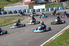 several racers on a go kart track