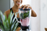 woman making a smoothie in a blender