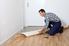 Man working with linoleum flooring