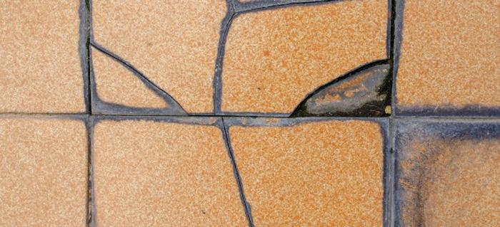 How To Repair Bathroom Tile In Steps DoItYourselfcom - How to replace bathroom tile floor