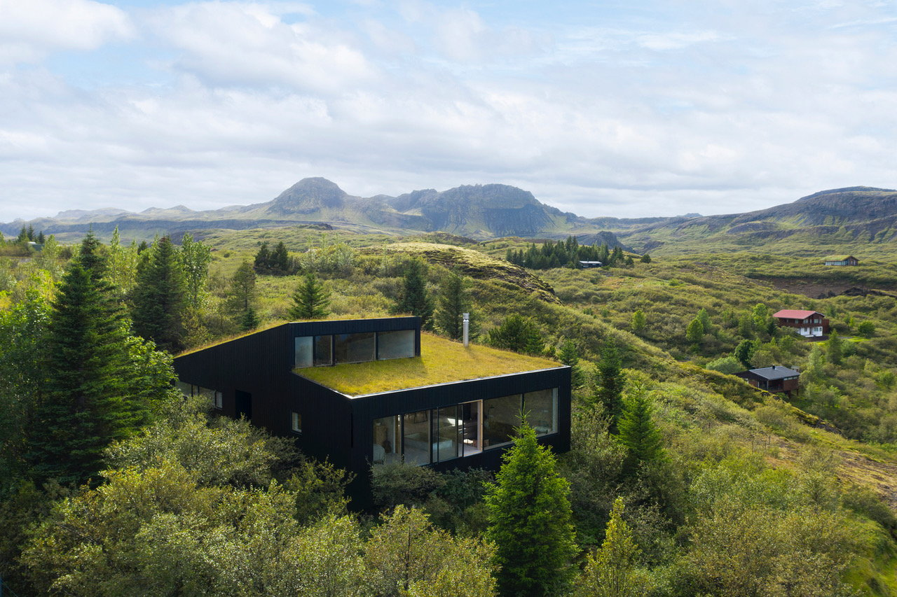 Moss-Draped Holiday Home in Iceland Bridges the Space Between Lakes and Mountains