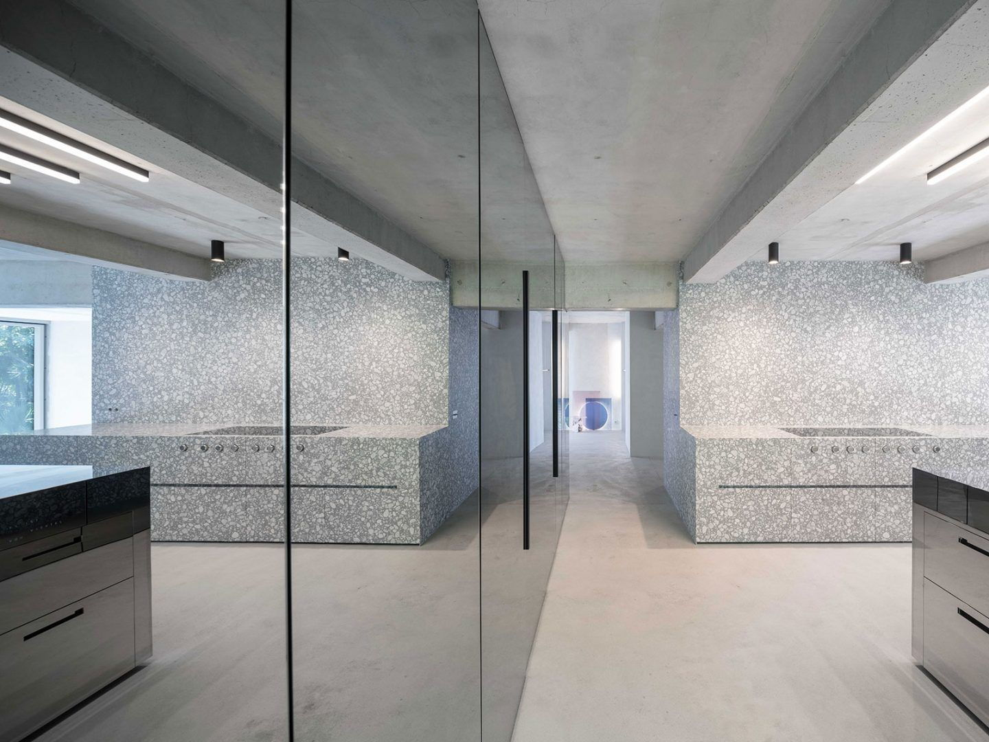 The interiors of Casa Morgana are filled with mirrors and speckled terrazzo surfaces.