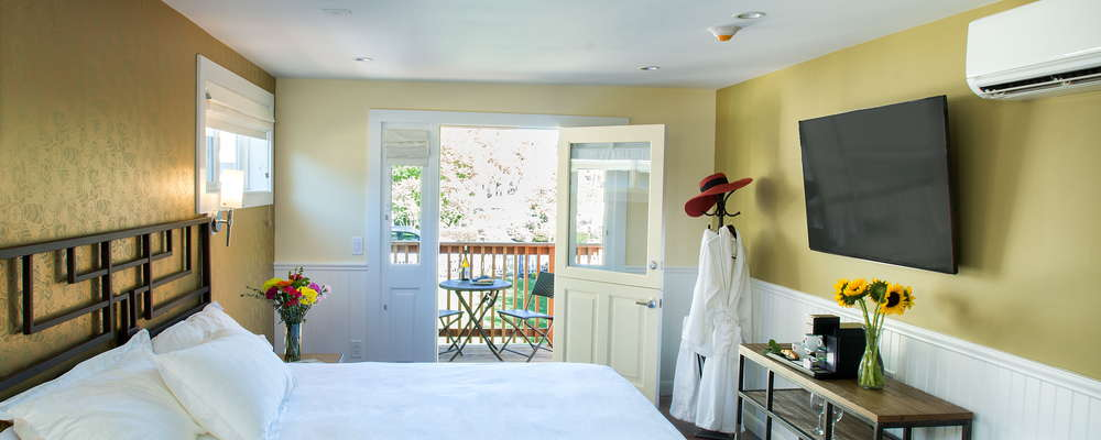 Elevated Deluxe King room with private deck & fireplace has luxe touches such as Frette linens, illy Espresso maker, flatscreen TV with premium streamed entertainment, ensuite bathroom with heated floors & rain shower.