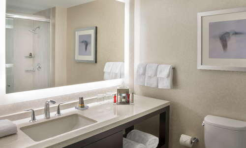 Newly renovated bathrooms provide bright light and the option for stand up shower or bathtub to suit your need