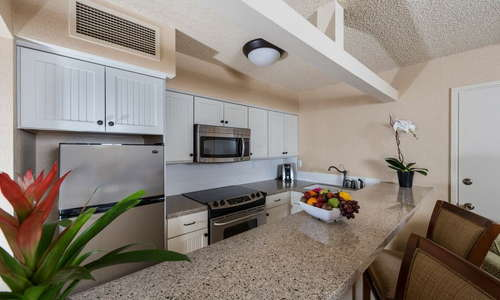 Convenient kitchenette with microwave, stove, oven, refrigerator, dishes and utensils, and coffee-maker