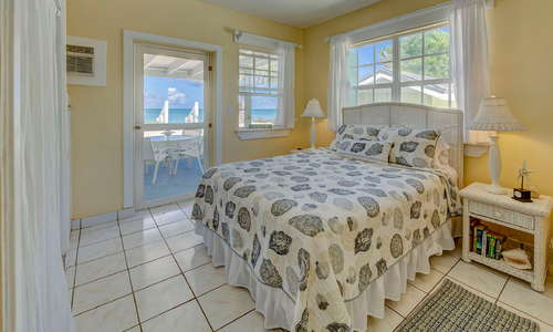Oceanfront bedroom that opens to the units private veranda with the sea right outside the door.