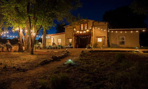 The barn and grounds lit up for a summer party