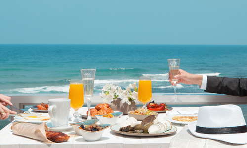 Rich buffet breakfast at the Carlton on the Beach overlooking the beatiful views of the Mediterranean