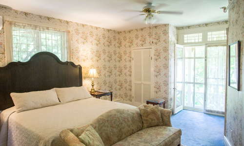 Our Romance in Lenox Room with a king bed, full bath and fireplace.