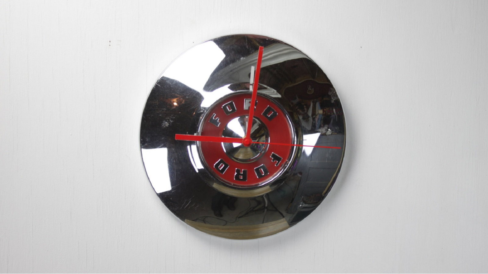 Get creative and turn an old hub cap into a clock.