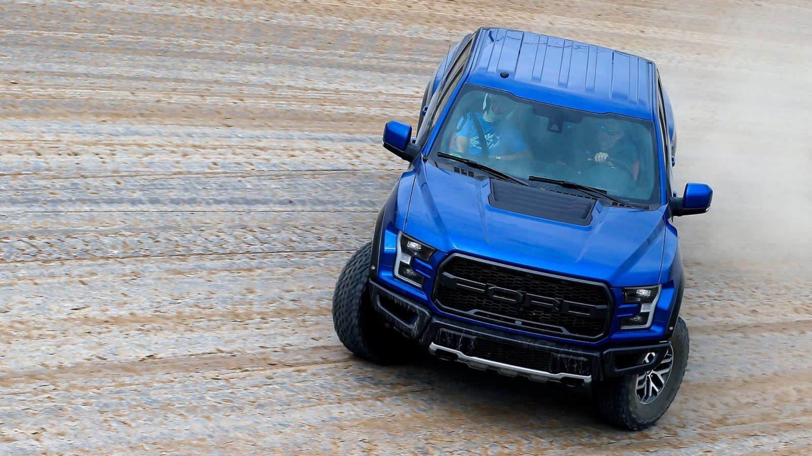 Ford raptor takes hot laps on the eldora nascar track ford trucks ford raptor nascar racer voltagebd Images
