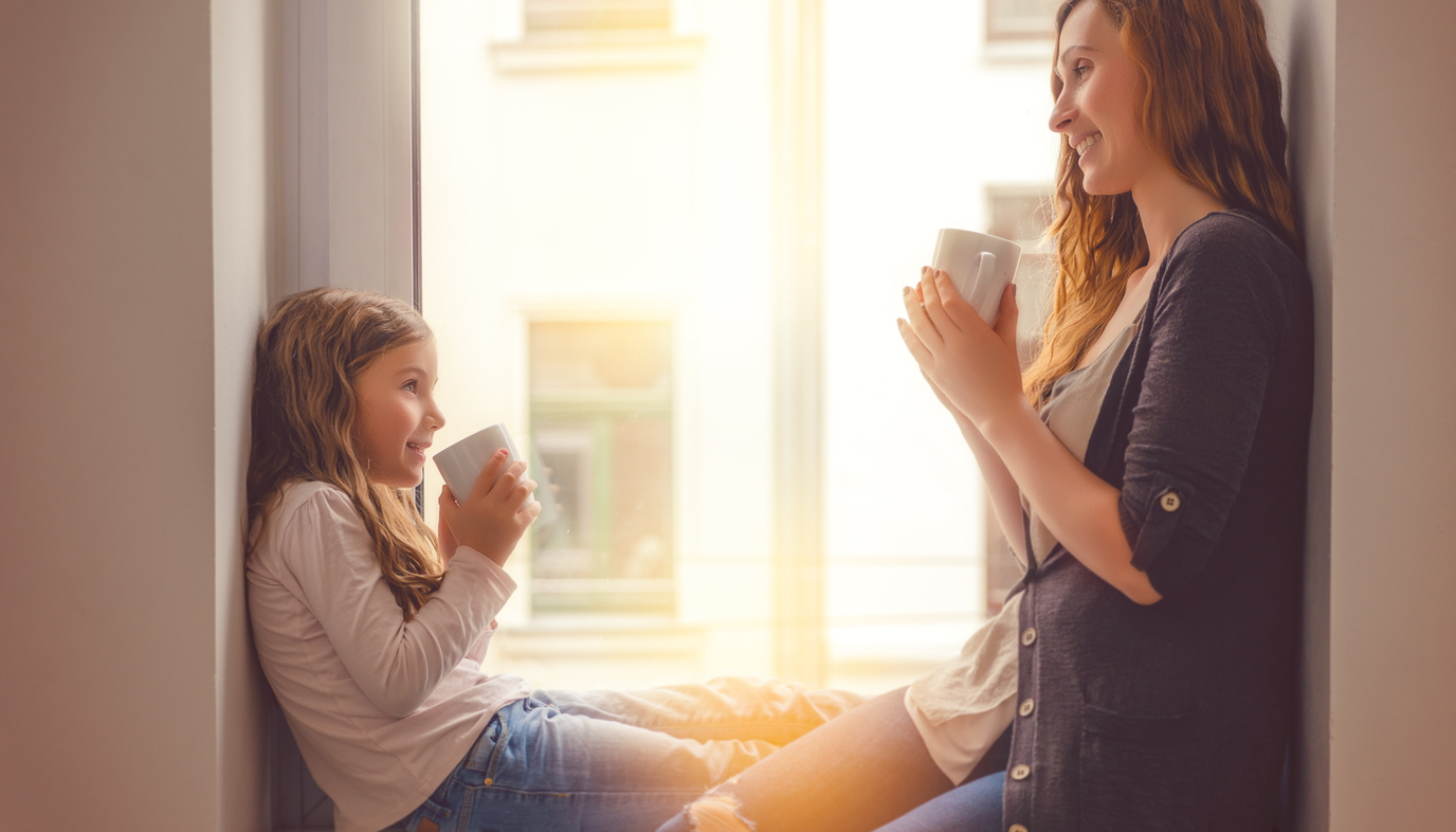 mom and daughter drinking coffee