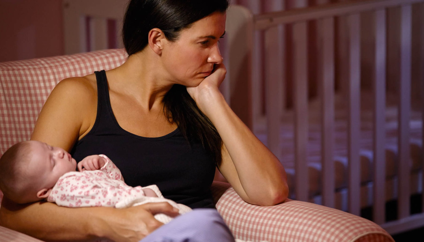 depressed mother holding baby