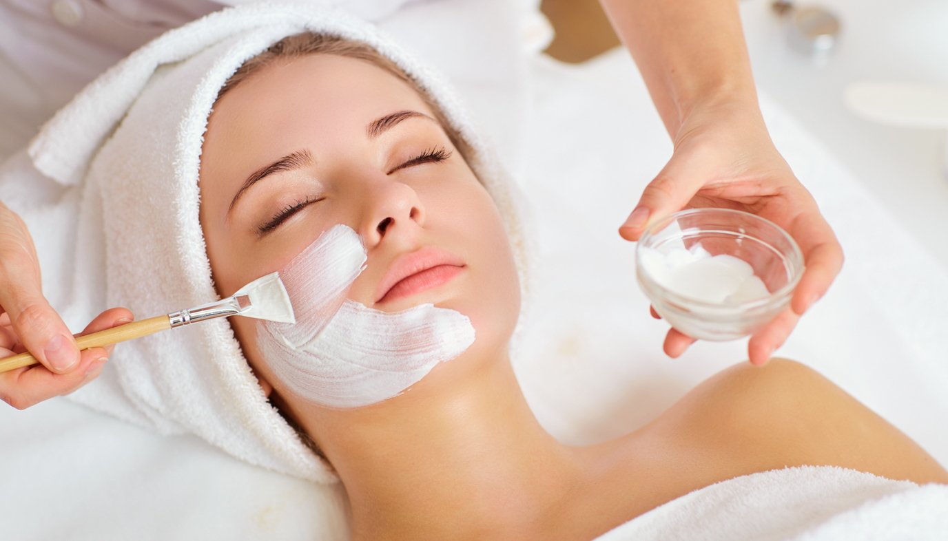 woman at a spa getting facial treatment