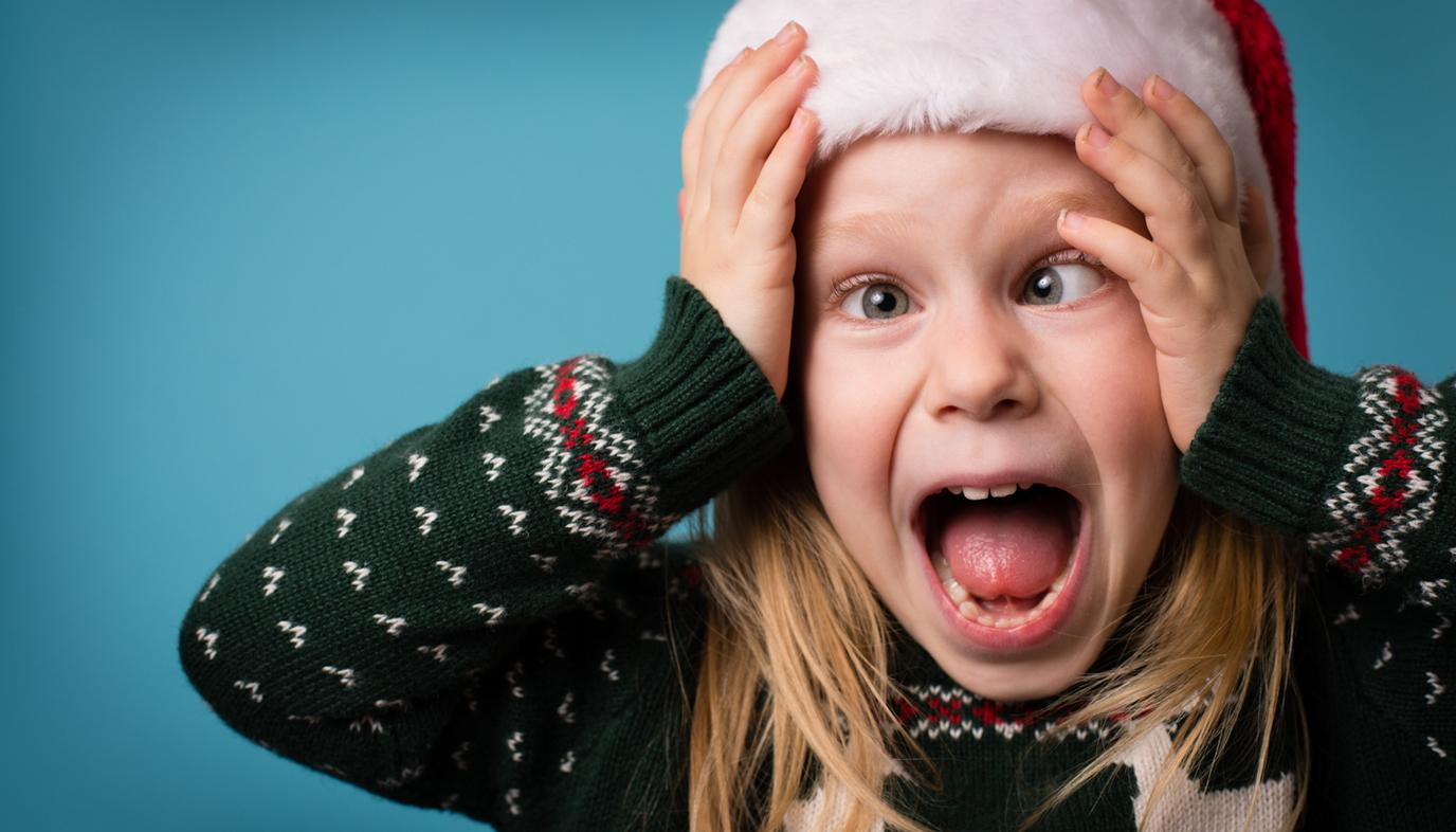 girl in Santa hat freaking out