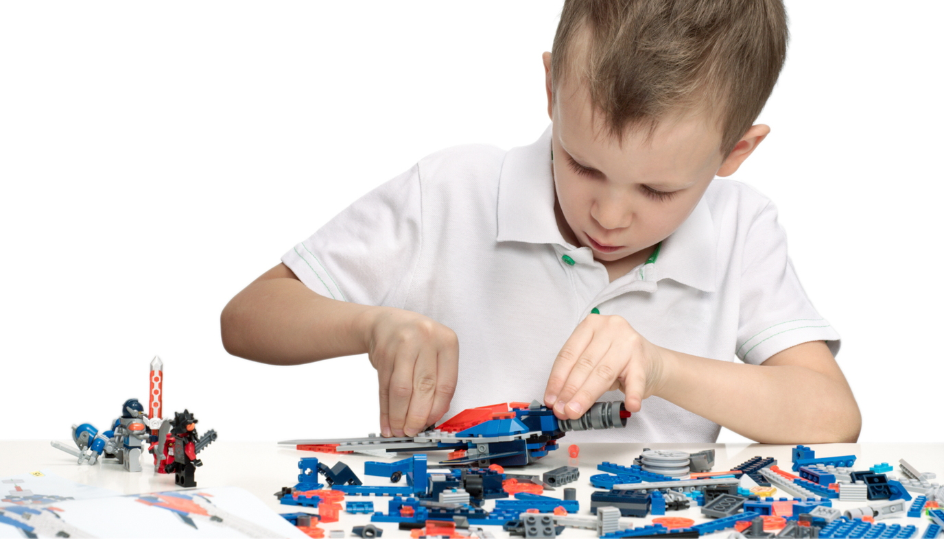 boy playing with construction set