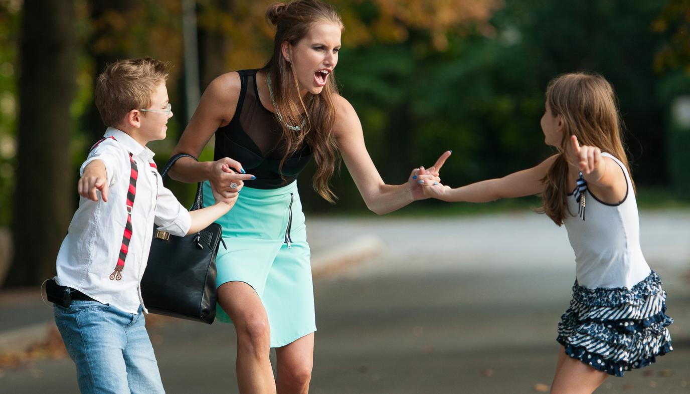 woman scolding children