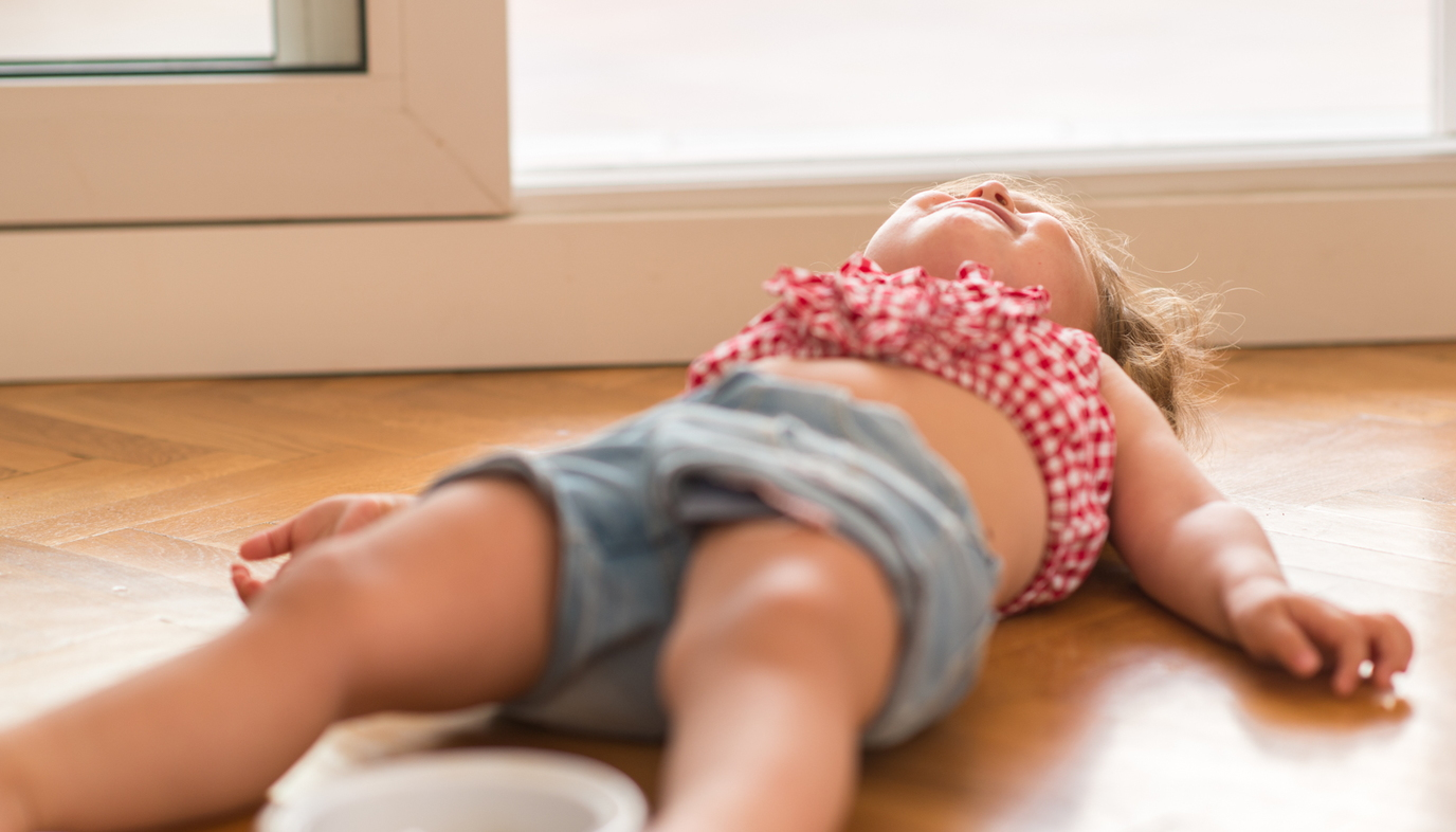 toddler having tantrum on the floor
