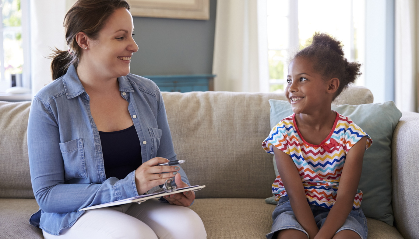counselor talking to smiling girl