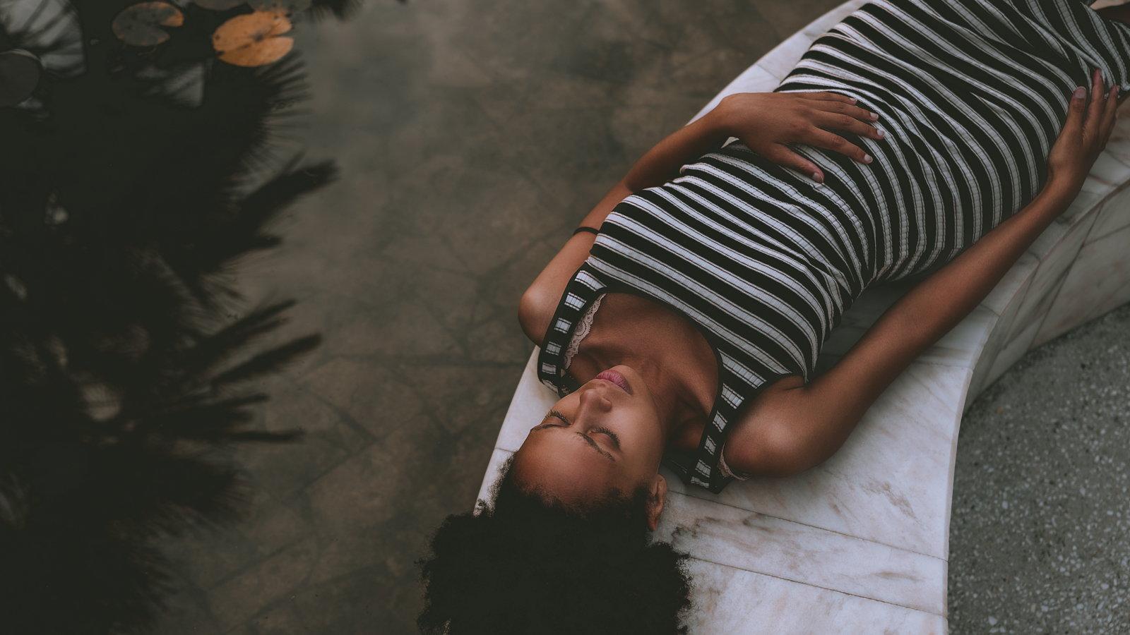 pregnant woman sleeping on body pillow