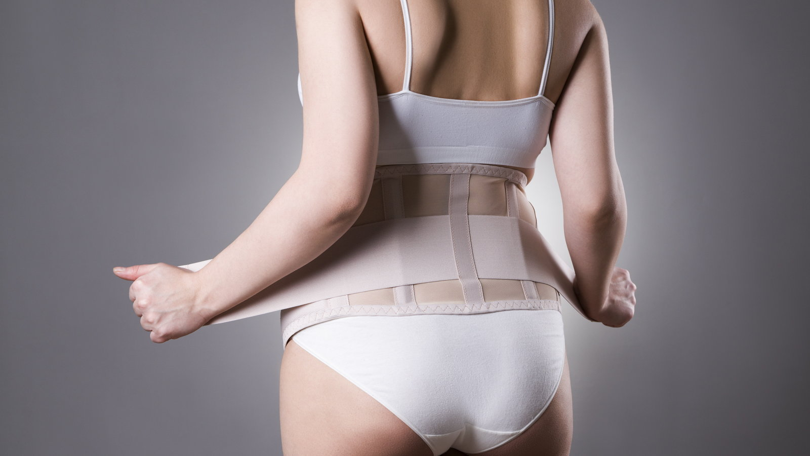pregnant woman wearing back support belt
