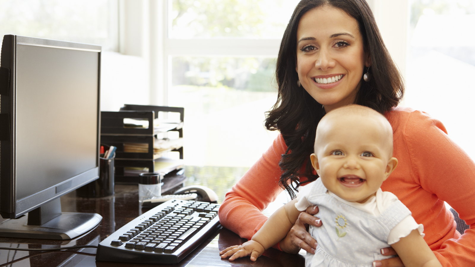 mom sitting at desk with baby