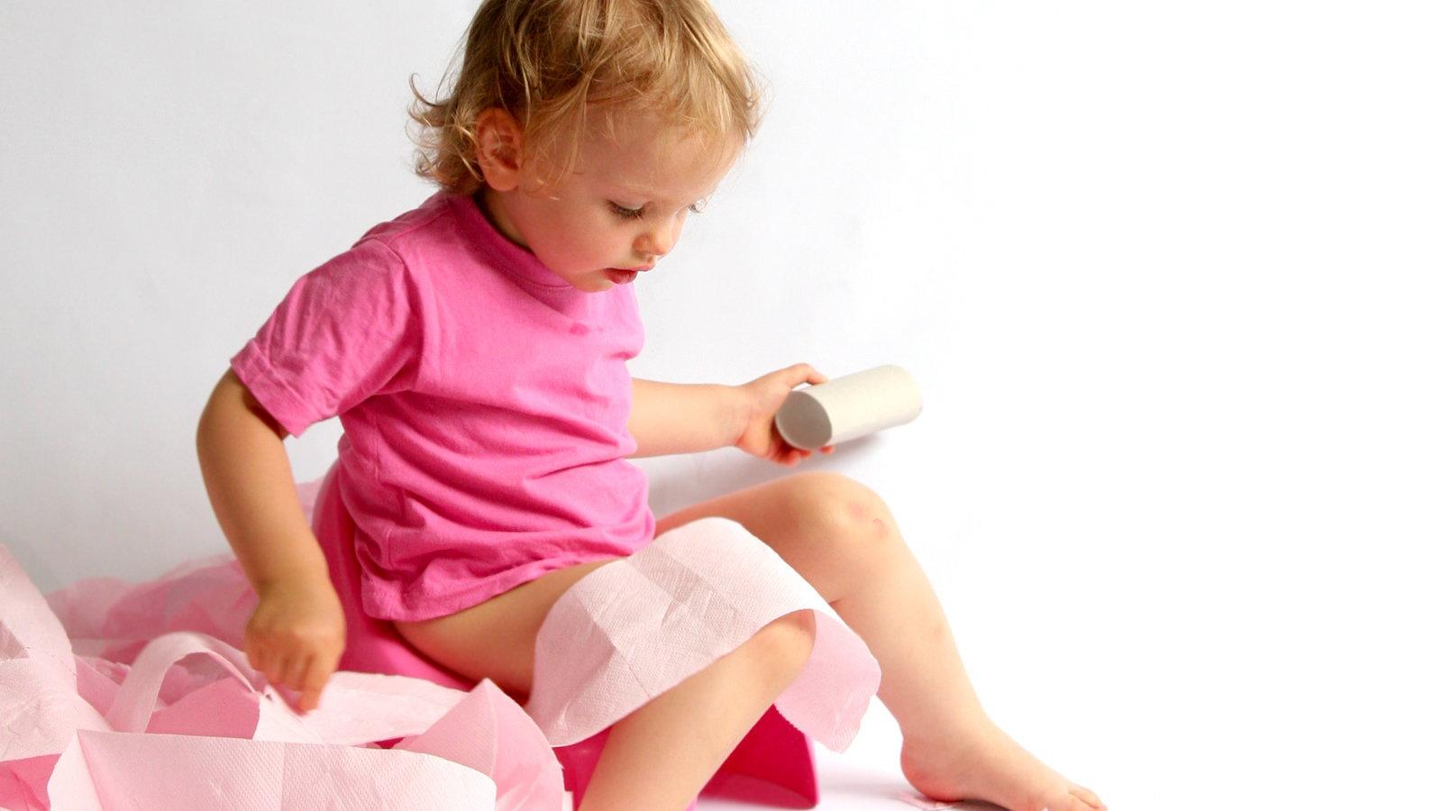 little girl on potty seat