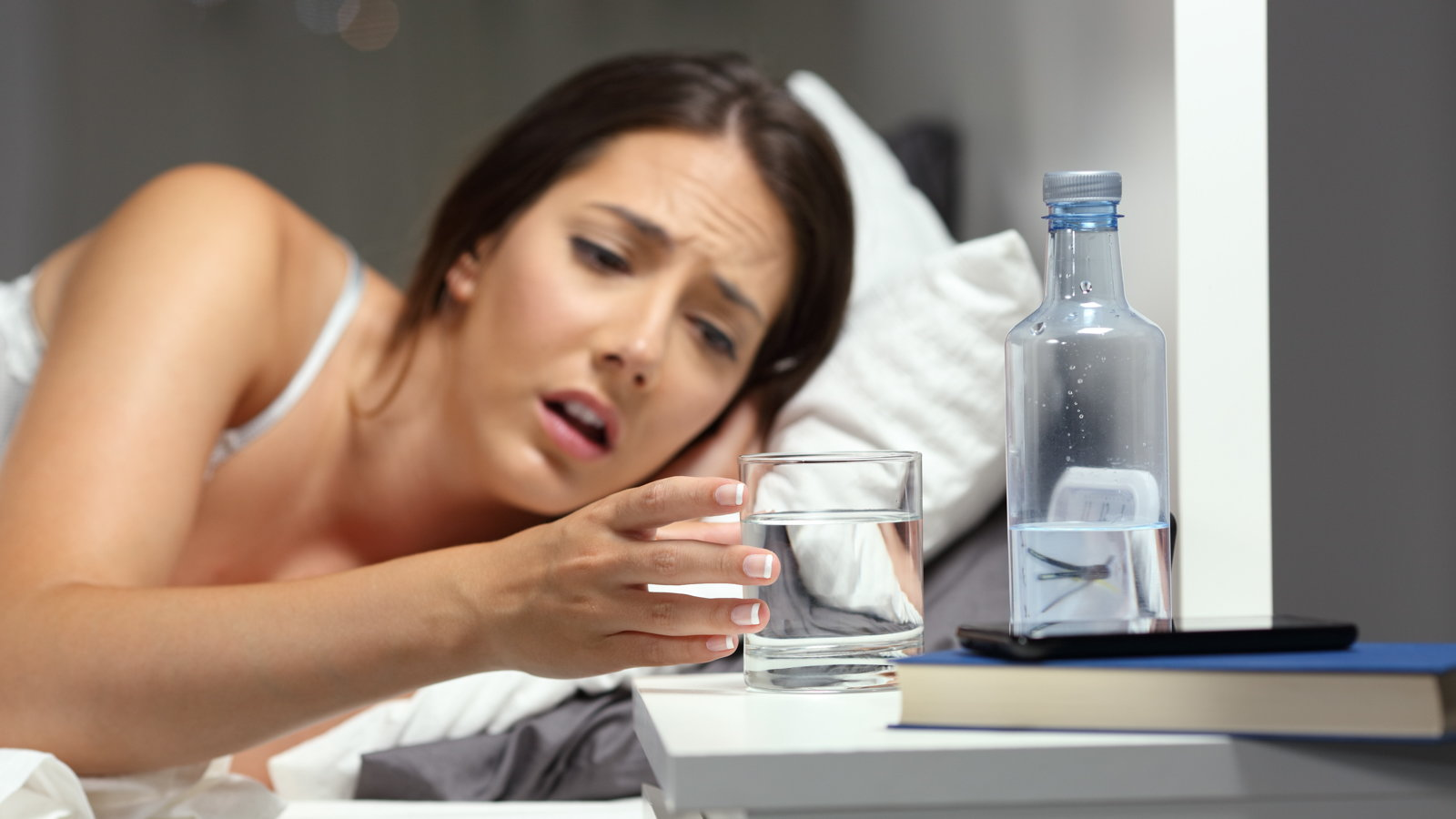 dehydrated woman drinking water