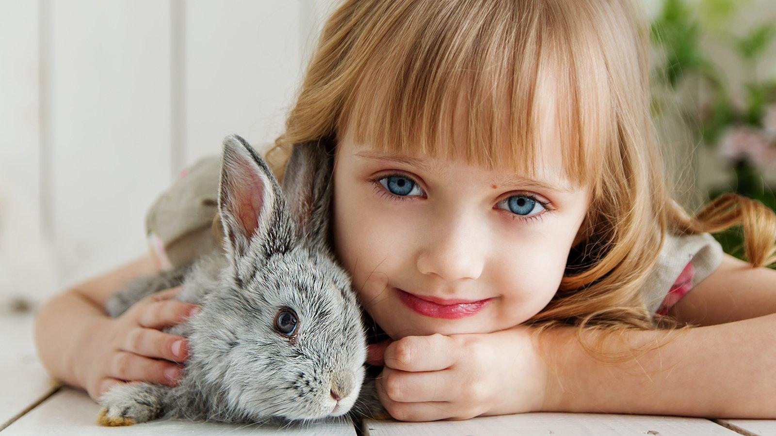girl with pet rabbit