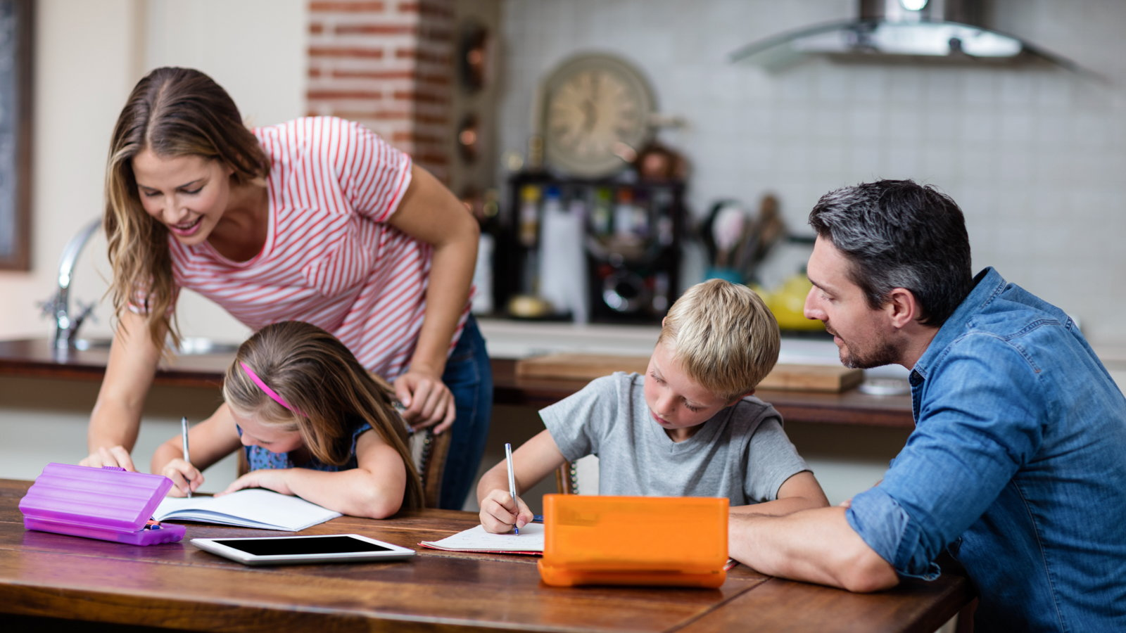 family doing homework with kids