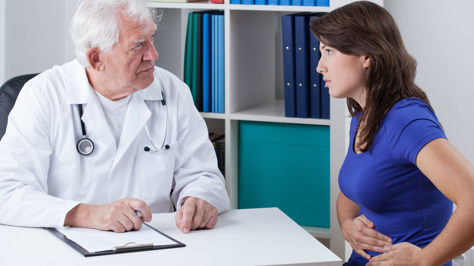 doctor talking to woman about ovarian cysts
