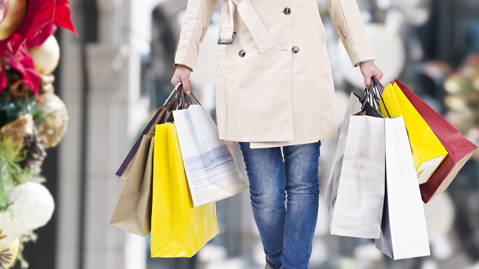 woman holding Christmas shopping purchases